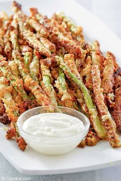 Longhorn Steakhouse Parmesan Crusted Asparagus is a tasty appetizer you can make at home. It's easy to make with this copycat recipe and video. Kick off your party with the best crispy, cheesy fried asparagus. #asparagus #appetizerrecipes #partyfood #parmesan #copycat #copycatrecipe