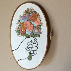 "Floral bouquet hand embroidery hoop art. Colorful flowers in hand. Hand stained 5"" x 9"" oval wood hoop. Home decor."