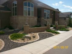 This xeriscaped front yard is small but easily done with landscape bricks and decorative rocks.