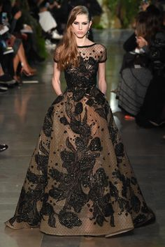 """Elie Saab's haute couture presentation of its Spring/Summer 2015 collection in Paris yesterday, was inspired by his native city of Beirut, which had been affectionately coined as the """"Paris of the Middle East"""" for its beauty, before the onset of civil war in 1975 lasting till 1990."""