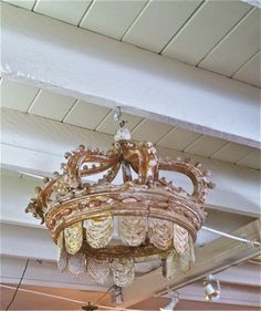 I want this!, old carved wooden crown hanging from the ceiling