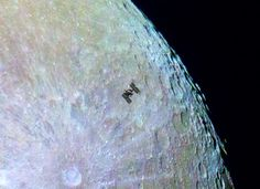 International Space Station flying across Moon