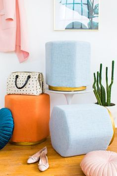 We're fulfilling those mid-century and gold decor dreams with these DIY metallic gold stool bases for transforming any ottoman! #diy #modern #ottoman