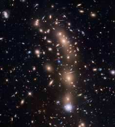 An unannotated view of the galaxy cluster MACS J0416.1-2403 taken by the Hubble Space Telescope -  Astronomers used this and two other clusters to find galaxies which existed only 600 to 900 million years after the Big Bang. - Credit: NASA, ESA, and L. Infante (Pontificia Universidad Católica de Chile)