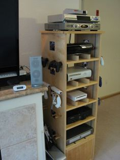 i love this home built AV/gamer stand, I'd want a gamer stand and a separate component AV rack i think