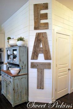 If you've got excess kitchen decor space, this would be a great way to rustically fill that space. u can make is as rustic as you want w/no pretty cut corners. DIY Reclaimed Wood Kitchen Sign [EAT] I'd like this for My far kitchen wall Wood Kitchen Signs, Reclaimed Wood Kitchen, Reclaimed Lumber, Rustic Kitchen, Kitchen Decor, Kitchen Ideas, Kitchen Letters, Wood Signs, Rustic Signs