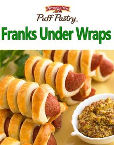 Franks Under Wraps Recipe. Pigs in a blanket take a spin in Puff Pastry. With only a few easy steps, this classic appetizer is ready to serve in no time. Wrap prepared Puff Pastry strips around halved frankfurters, brush with an egg wash and pop in the oven. It's that simple! Serve Franks Under Wraps at your next party with a side of grainy mustard. They also make great Mummies for Halloween!