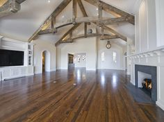 Reclaimed wood; beams and oak flooring. Love the paneling on the ceiling as well.