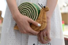 """Garden Party For the wicker woman, Kate Spade introduced garden-themed handbags, including ones that resemble a snail, a watering can and a birdhouse that says """"No Vacancy."""" - Fashion Week Now Spring 2015 - NYTimes.com"""