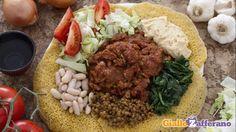 Lo zighinì è composto da uno spezzatino di carne, che può essere sia di manzo che di pollo, verdure e legumi vari, come accompagnamento, il tutto servito su forme di pane injera, che viene usato come cucchiaio per mangiare il tutto. Qui la #ricetta: http://ricette.giallozafferano.it/Zighini.html  #GialloZafferano #ricettedalmondo #Africa