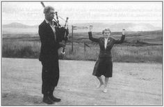 Dochy Johnstone playing the bagpipes with wife/partner dancing. They were tinker folk who used to stay at a rather untidy makeshift campsite nearby at Kenmore when I was a child living at Styx nearby.  We would regularly bump into this wondrous & mysterious family; always a source of entertainment. Circa early 1960's # currently the source of picture is uncertain.