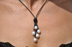 This beautiful Pearl and Leather Lariat necklace goes perfect with any wardrobe choice. There are 5 AAA quality 12mm rice pearls on fine quality 2mm naturally dyed black leather. It also is available in many leather colors.  There are 2 choices in style: (Let me know in comments when ordering.) 1. A fixed length with a 12mm pearl button clasp making the necklace part hang 18 inches while the Lariat parts hang to 2 3/4 more inches. 2. Two sliding pearl knots giving you a variety of lengths…