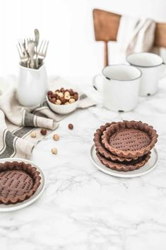 Cocoa and extra virgin olive oil tartlets with hazelnut spread mousse