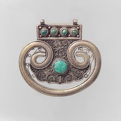 Pectoral Ornament, silver; filigree, set with cabochon and table-cut turquoise. Khotan, late 19th–early 20th century
