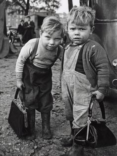 Paris 1962  Photo:  Christer Strömholm - carrying their moms' pocketbooks? These little boys are so precious....