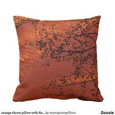orange throw pillow with Asian flavor