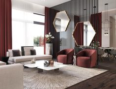 These moody burgundy shades make the mirror decor in this living room stand out. Try these colors in your own living room designs | #decoraid
