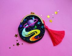 Olya Moore is the talented artist behind Oliness Art Studio, an online shop where she sells her hand embroidered space themed purses and brooches.Her work consists of thread and tiny glass beads, pleasantly arranged to create tiny universes that fit in the palm of your hand. Vibrant, bright and dreamy Olya's work truly reflects the ...