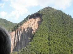 landslide The downward falling or sliding of a mass of soil, detritus, or rock on or from a steep slope.