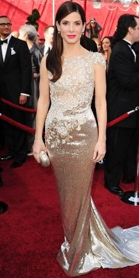 """Sandra Bullock, 2010  """"The dress does make the woman,"""" joked Sandra Bullock of her embroidered silver Marchesa gown. Not so! The peek-a-boo design perfectly showcased the star's lithe shape."""