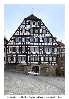 Fachwerkhaus am Marktplatz (mk) fachwerk in Germany is mostly always dark with white plaster - related to tudor but look at the difference of building (most wood is a dark brown but did see some red and different brown)