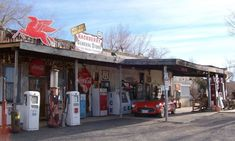 """Described by one Tripadvisor member as """"old stuff on steroids,"""" this roadside attraction is part museum, part store. You'll find a yard dotted with antique cars, old gas pumps, and picnic tables, while the interior boasts walls of kitschy mercantile signage. Grab a cold root beer and a Route 66 souvenir on your way out. hackberrygeneralstore.com"""