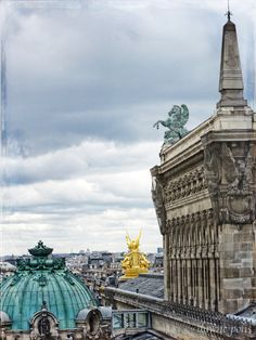 A a great photo from the rooftop of Galeries Layfette. I've always loved the way the gilded statues glow  against the grey Paris skies.