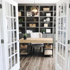 I like the desk in this one, but I'm not sure about the dark bookshelves. The french doors are so pretty!