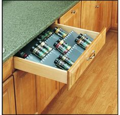 In Drawer Spice Rack. I Want One!