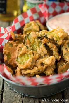 Wicked Pickles - An addictively delicious beer battered, deep fried pickle appetizer served with a spicy dipping sauce!