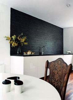A kitchen dining table set with black and white tableware from Living Etc.