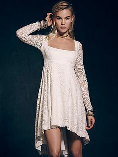 Petit Trianon Dress | Party the night away in this lace dress with a high low crochet hem.  Sheer lace sleeves.  Hidden side zip.  Lined.