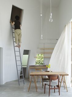 Light white contemporary country - original pin note: Japanese studio Tato Architects have converted a warehouse in Osaka into a house where residents can climb up the walls.