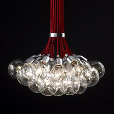 Ilde Max light fixture, design David Abad 2002. Elegant cluster of 19 simple sockets with clear globe bulbs and stainless steel ring.
