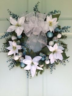 Winter White Poinsettia Christmas Wreath by PickingPetals on Etsy,   I like this but with red instead of blue accents.