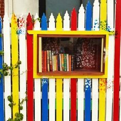 My fence will never be painted like this, but it's a cute idea to have the library inset into the fence.