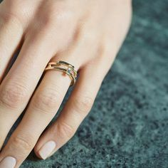 White Baguette Diamond Ring in Yellow Gold