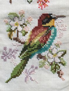 cross stitch colourful bird