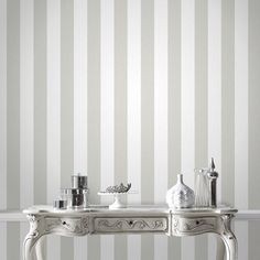 Ariadne White / Silver Wallpaper by Graham and Brown Ariadne W . Ariadne White / Silver Wallpaper by Graham and Brown Ariadne White / Silver Wallp Striped Wallpaper Gray, White And Silver Wallpaper, Gray Striped Walls, Metallic Wallpaper, Gray Stripes, Vertical Striped Walls, Geometric Wallpaper, White And Silver Bedroom, Glitter Wallpaper Bedroom