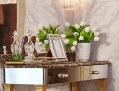 Detailed: Pictured above is an ornate table - complete with pictures frame, a vase of flowers, a brush and a perfume bottle