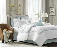 A soft seafoam blue is the accent color used in this beach themed king-size comforter and shams playing up the seashell and sand dollar embroidery.