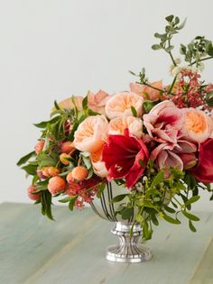 DIY Holiday Centerpiece by Tulipina via cocokelley: Made with Poinsetta, Amaryllis, Roses, Mistletoe. Dogwood Branches  and Christmas Bush. #Flowers #Centerpiece #Holiday