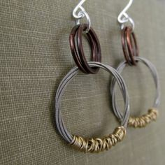 Gift for Her - Handmade Jewelry Upcycled Guitar String Hoop Dangle Earrings // Salvaged Guitar String Mixed Metal Earrings // Recycled Guitar String Wire Wrapped Earrings. $38.00. http://aftcra.com/thechestnutforge/listing/2903/guitar-string-hoop-dangle-earrings-salvaged-guitar-string-mixed-metal-earrings-recycled-guitar-string-wire-wrapped-earrings