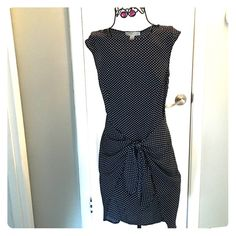 Michael Kors navy/white polka dot dress size 4 Michael Kors navy/white polka dot dress size 4: -100% polyester (silky feel), hidden side zip, cap sleeve, one length all around with additional long layer in back that ties around to front MICHAEL Michael Kors Dresses High Low