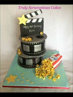 Cake for a movie lover Cake film reels and pop corn with fondant movie clapper