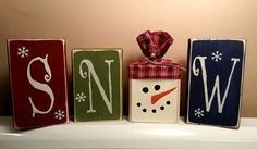 This whimisical snowman block set warms the heart with Frostys cute little face representing the O in SNOW.