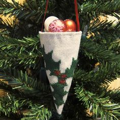 free... Cross Stitched Victorian Cone Ornament... The Victorian English decorated their trees with homemade ornaments. They would use scraps of ribbon, paper, pictures from magazines, etc. The small hanging cone would be filled with treats or decorative items.  This one is made from fabric & decorated it with some easy cross stitch. You could also add beads, bells, etc.