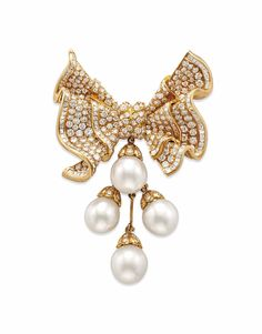 A CULTURED PEARL AND DIAMOND BROOCH Suspending four articulated drop-shaped cultured pearls, measuring approximately 12.95 to 12. 25 mm, to the circular-cut diamond undulating bow surmount, mounted in 18k gold