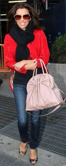 Eva Longoria in red sweater, and Valentino bag