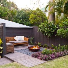 Privacy Fence tied into the back of the garage. Nice enclosed feel with seating and tall fence.